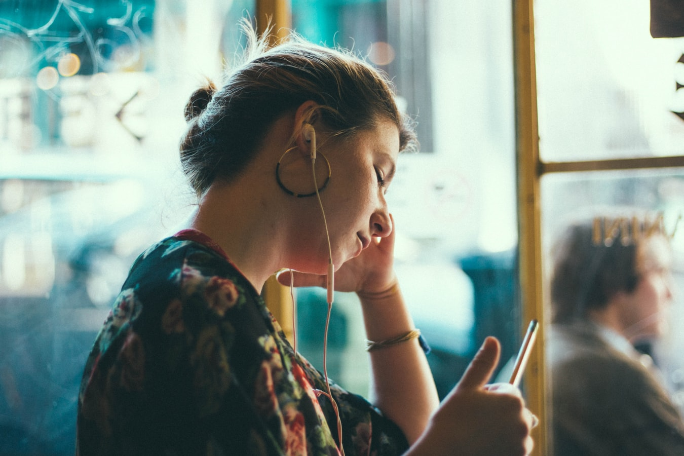 woman browsing through self care podcast on smart phone