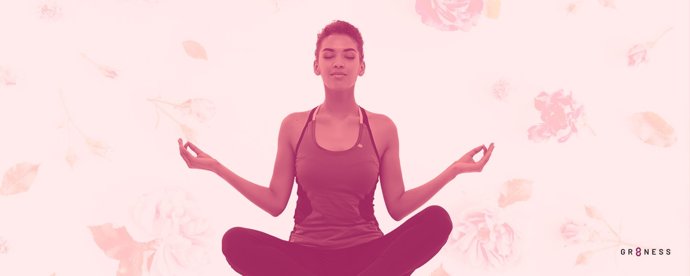woman meditating with eyes closed and legs crossed