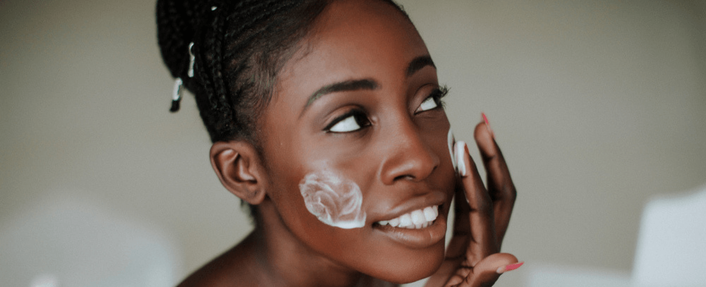 Young girl applies spf makeup to her face