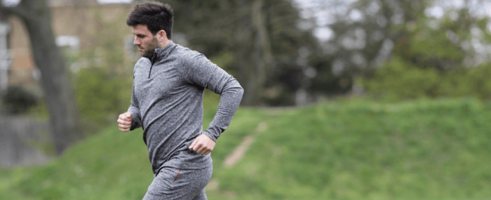 man in grey workout clothes running