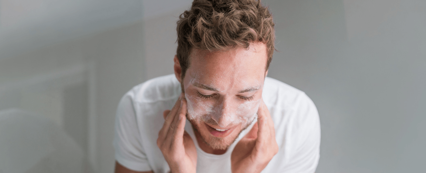 man washing face for his skin care routine