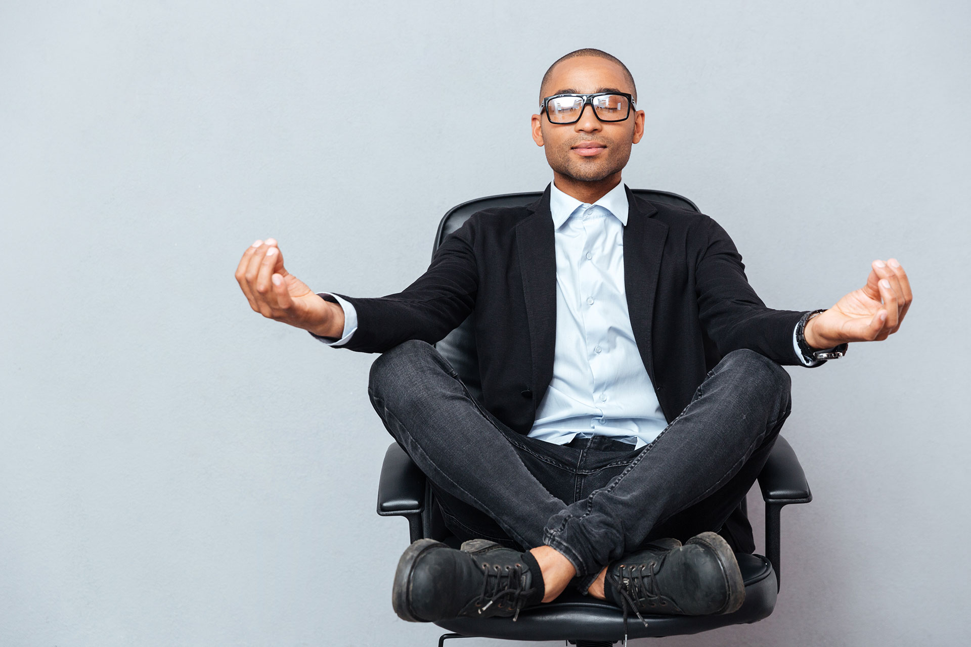 a business man meditation at work in his office chair