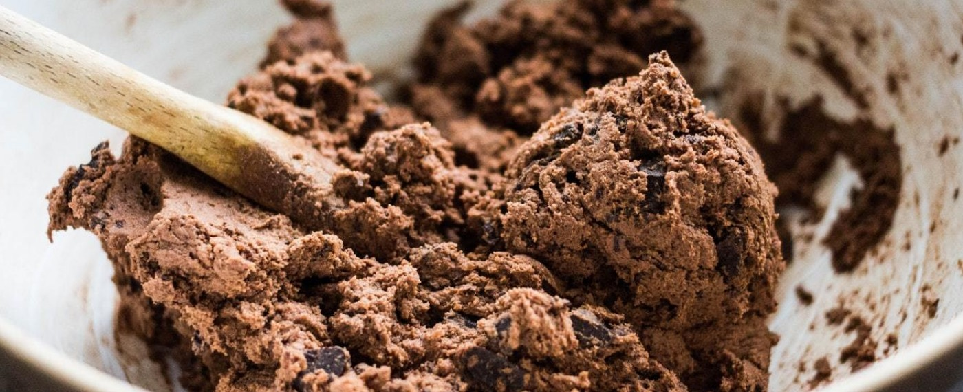 a bowl of chocolate chip cookie dough made from healthy no bake recipe