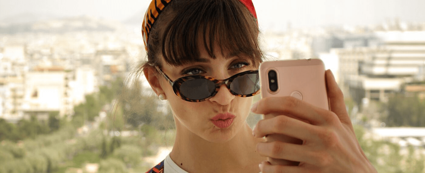 Stylish lady taking a selfie with her phone