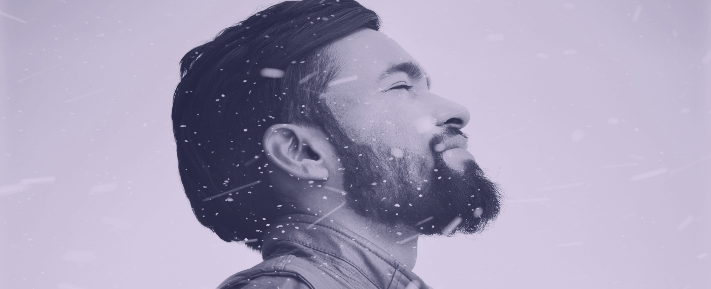 man meditating and breathing in the snow