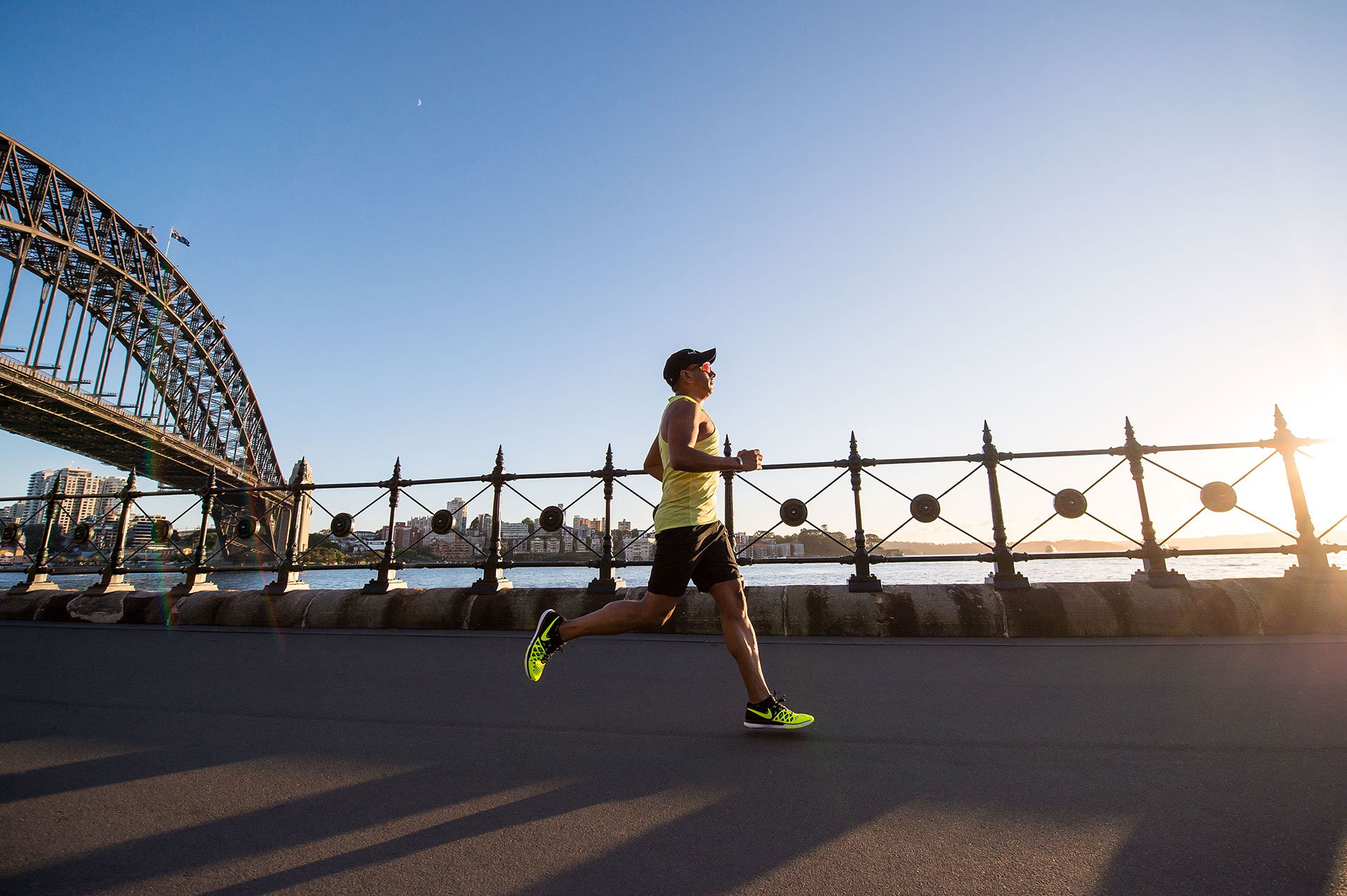 A man triumphantly jogs by a bridge, overcoming initial reluctance