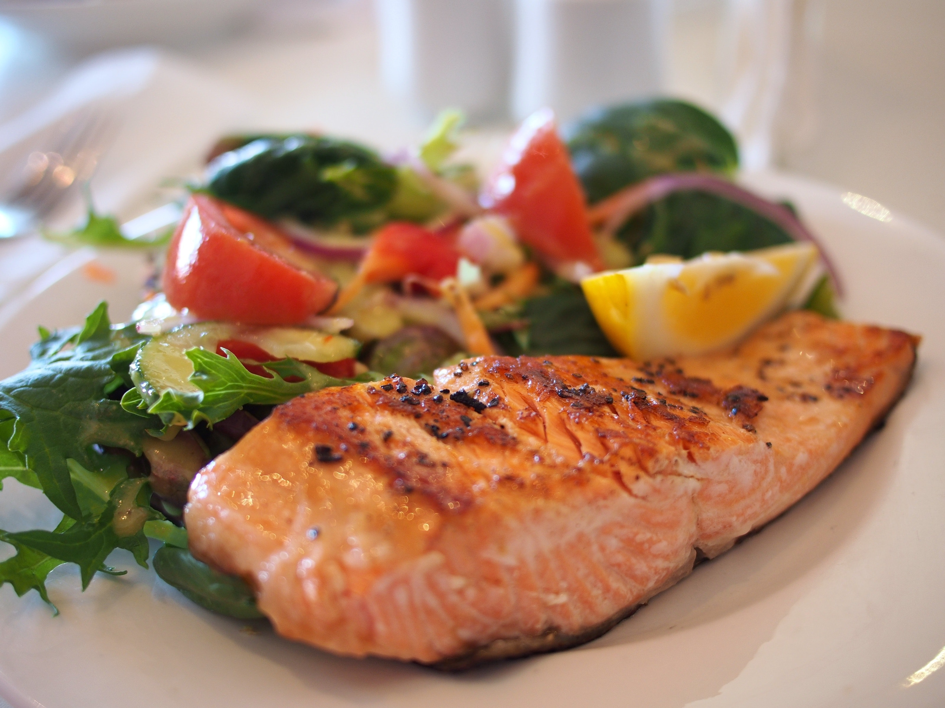 A plate of seared salmon and vegetables
