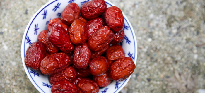 A bowl of dates that improve gut health by reducing toxicity in the gut