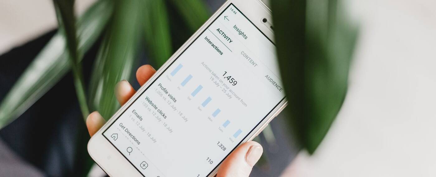 Smartphone displaying social media insights for mental health