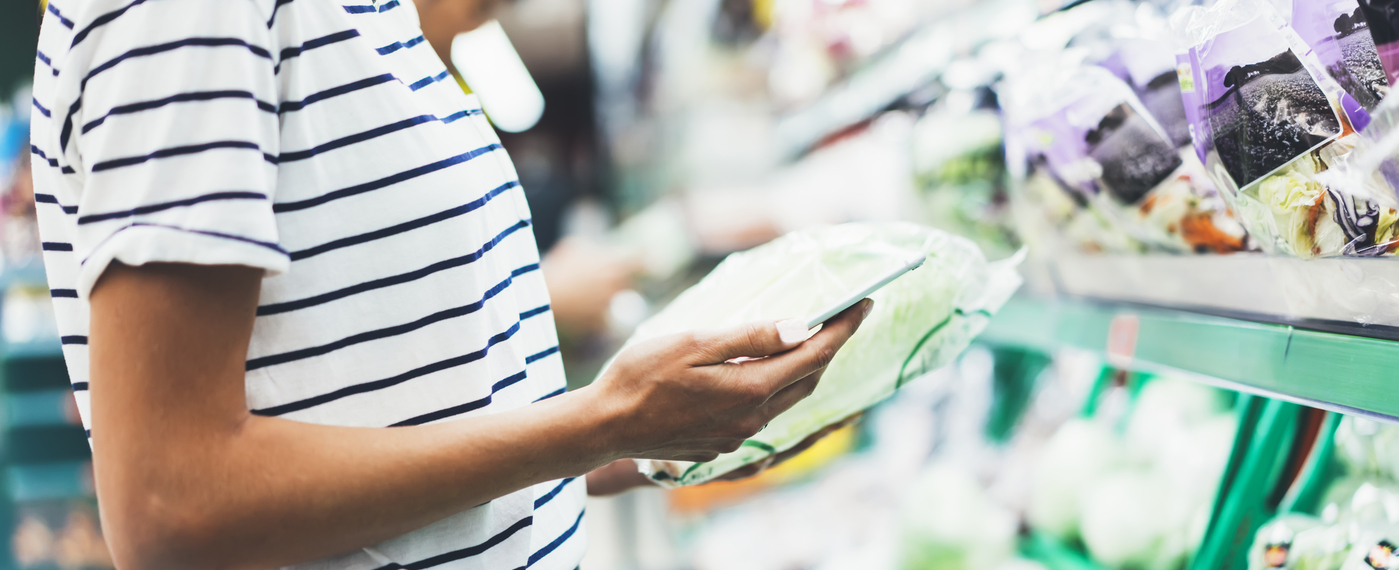 A female shopper uses an app to save money on groceries