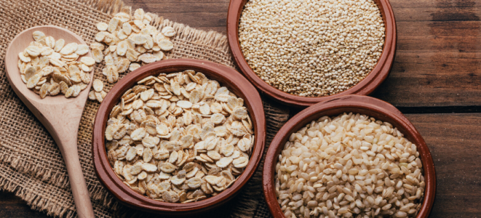 Bowls of oats, quinoa, and grains that help speed up digestion and improve gut health