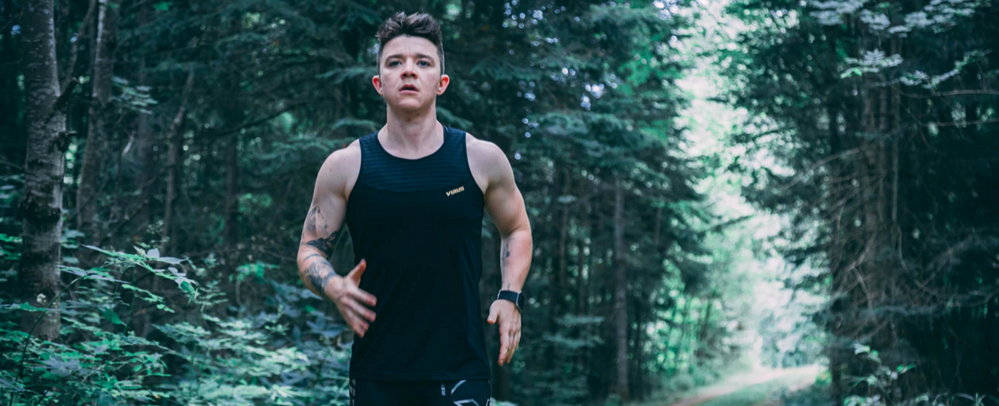 Young man jogging outside