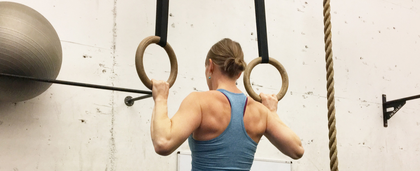 Woman working out with gymnastics rings