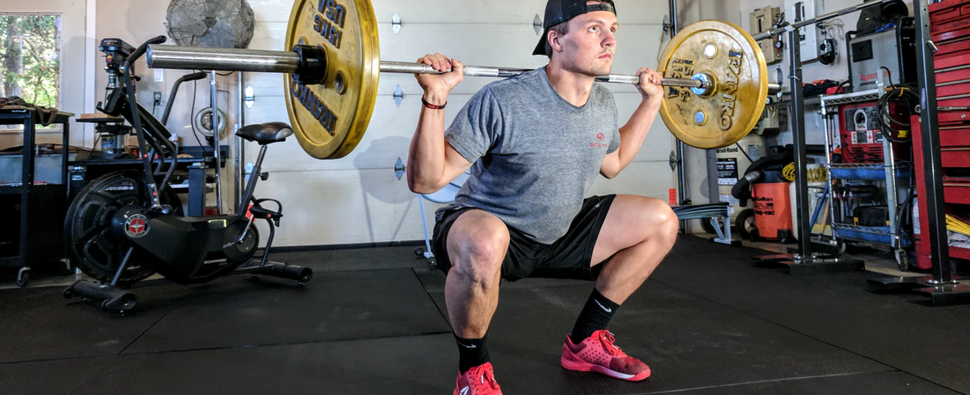 Young male lifting weights in the gym
