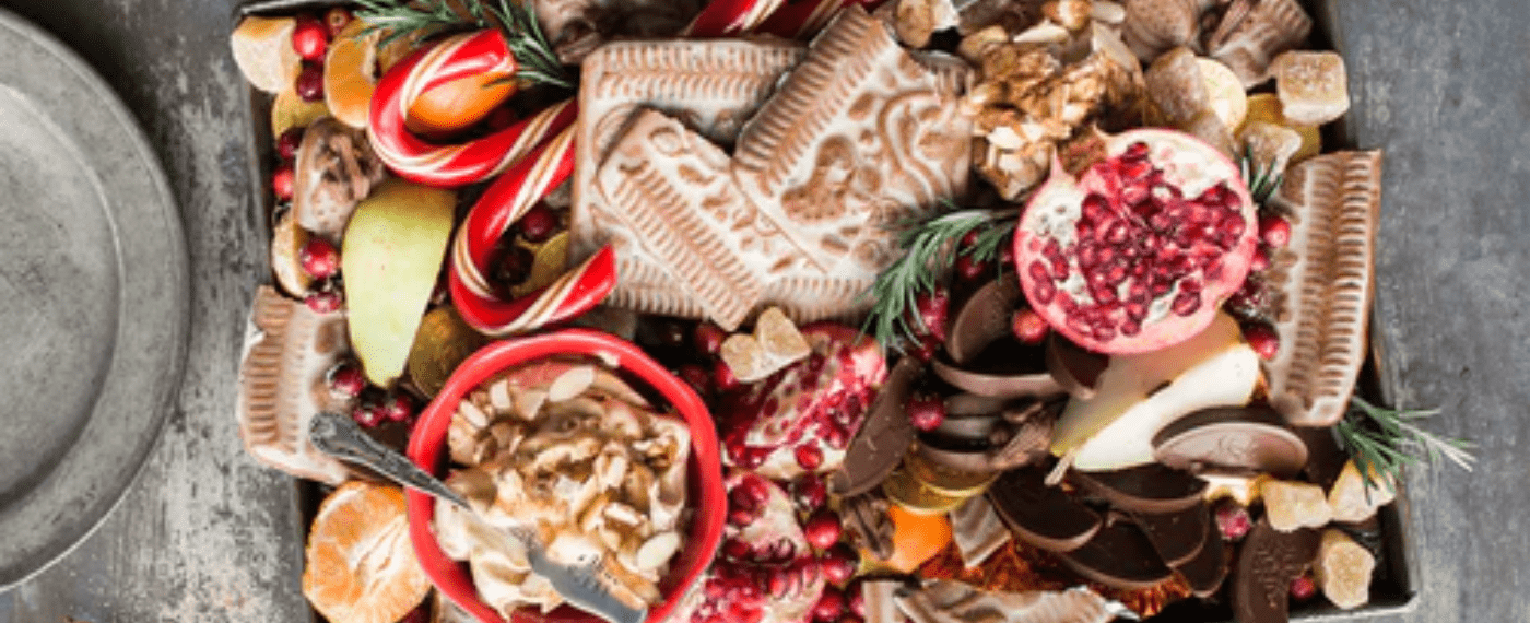 A holiday basket filled with different sweets and cookies