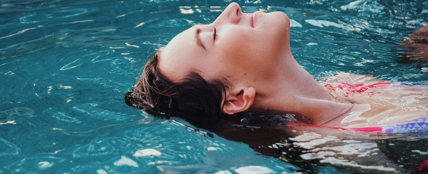 A woman relieving stress while submerged in an isolation tank