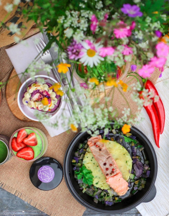 a selection of gluten-free options next to a vase of colorful flowers