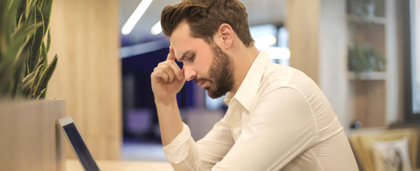 man stressed out while at work