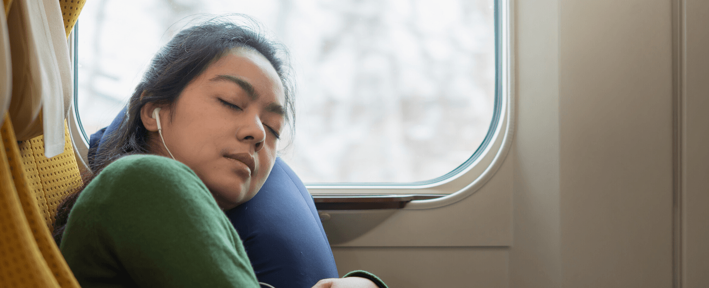 A woman sleeps during a long commute