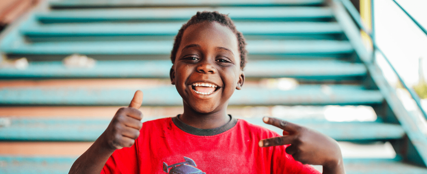 young boy smiling going into kindergarten