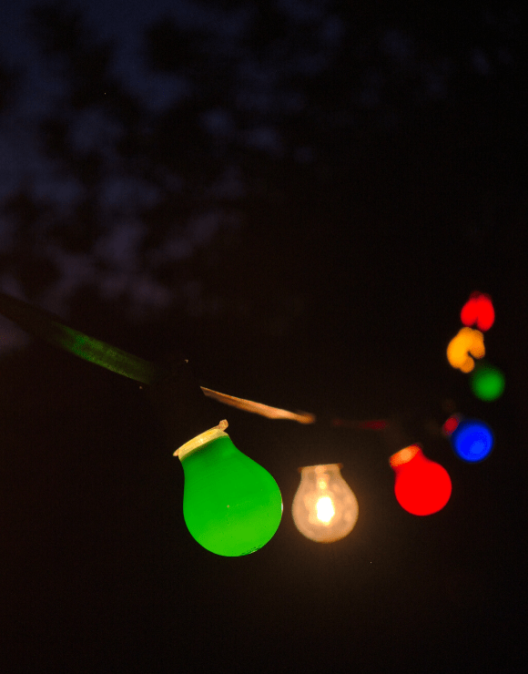 string of festive light bulbs hanging in a row