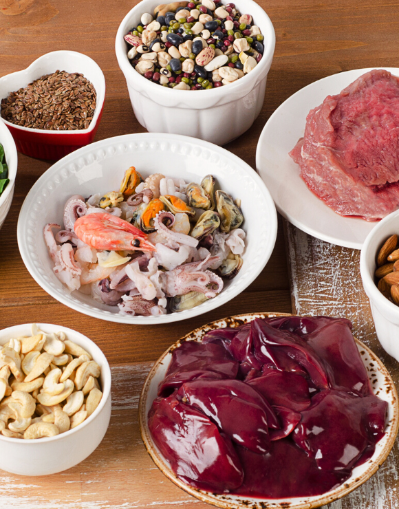 A variety of foods rich in zinc including liver, seafood, and nuts