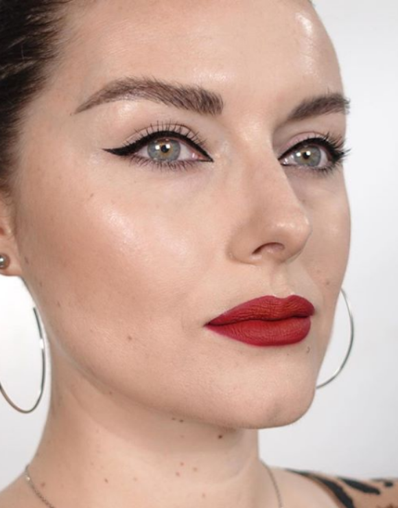 Woman modeling retro glam makeup style