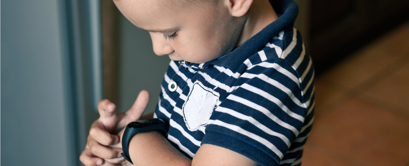 Young boy adjusting his Fitness Tracker Watch