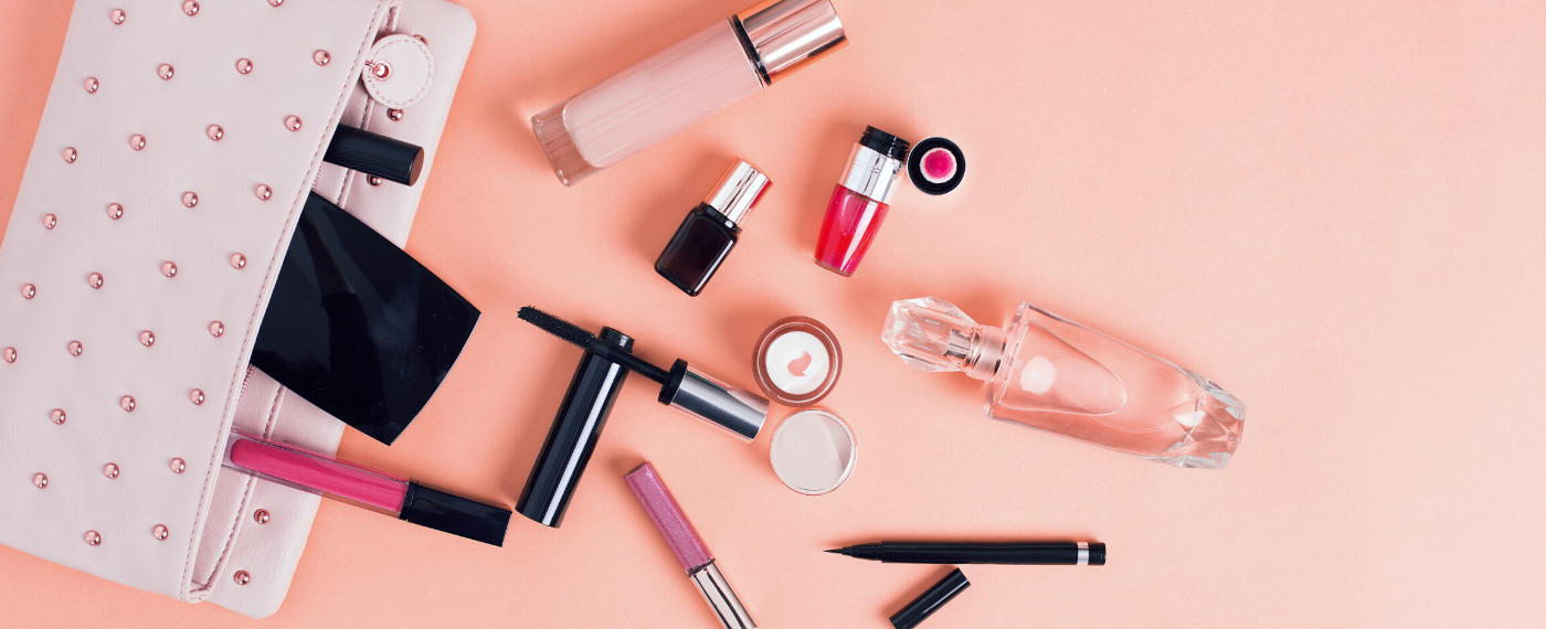Makeup products spilling out of a makeup bag