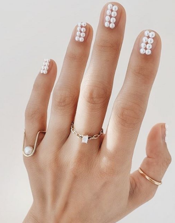 manicured nails with little pearls on each nail