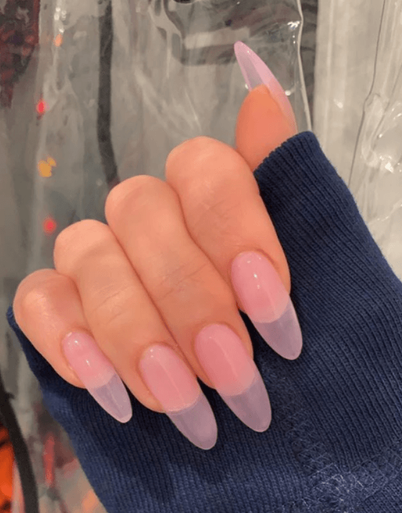 up-close shot of trendy manicure with sheer nail polish