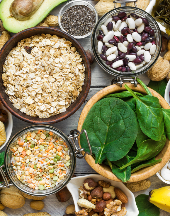 A variety of healthy foods rich in magnesium such as oats, beans, and spinach