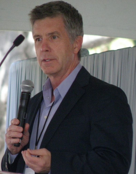 Tom Bergeron holding a microphone during a speech