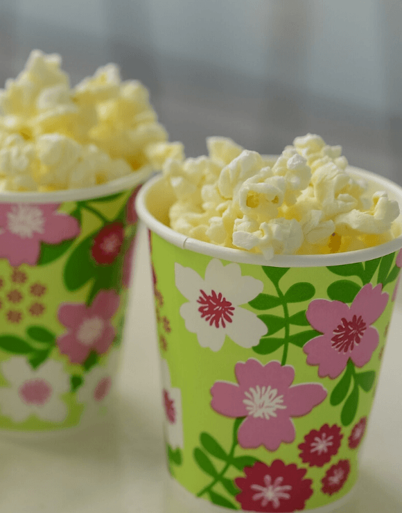 Small floral designed cups filled with popcorn