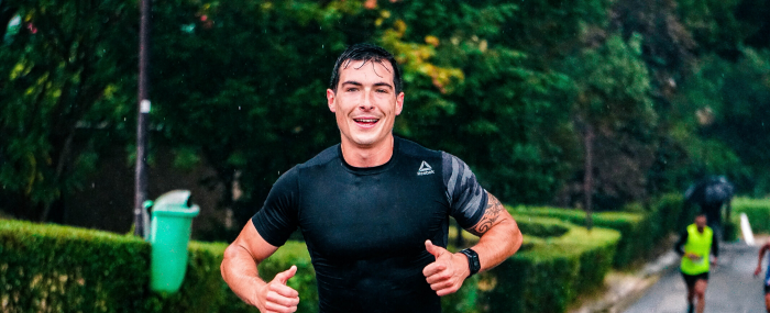 Athletic male running the rain to stay active for 2020